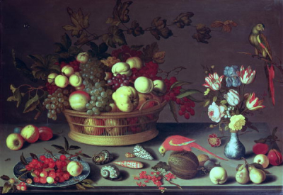 A basket of Grapes and other fruit